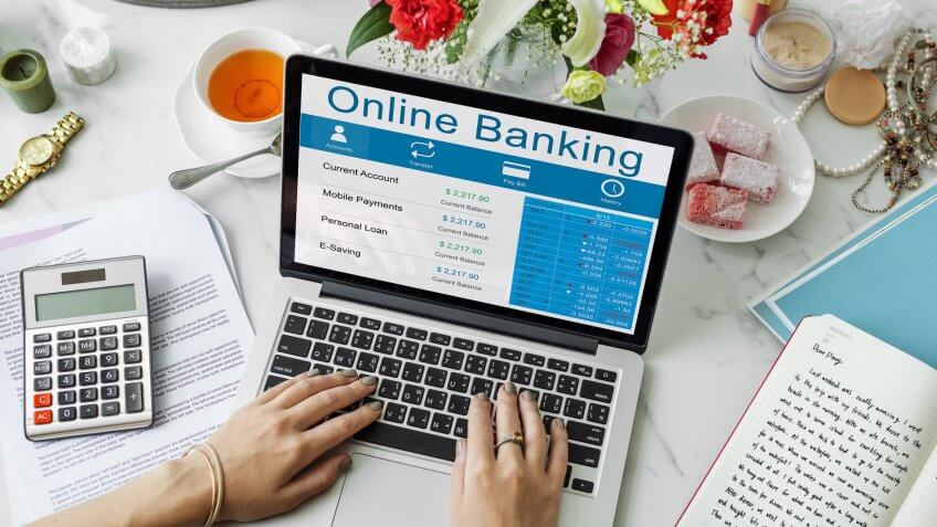 woman looking at balance on banking website