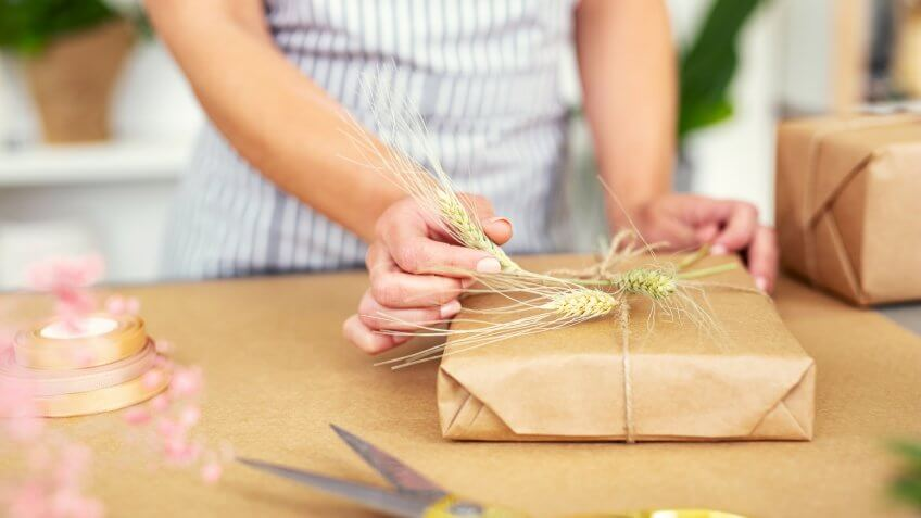 woman wrapping holiday gift