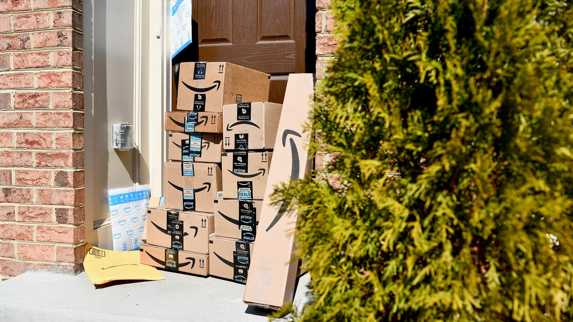 WASHINGTON DC, USA - MARCH 15, 2018: A large Amazon Prime delivery consisting of several packages delivered to the front door of a home.