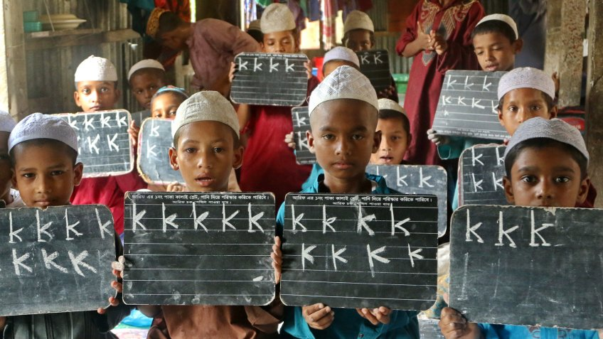 Dhaka, Bangladesh - September 8, 2015: Children attend class at a Madrassah, a traditional Islamic school in Bangladesh, in a village in Munshiganj district.