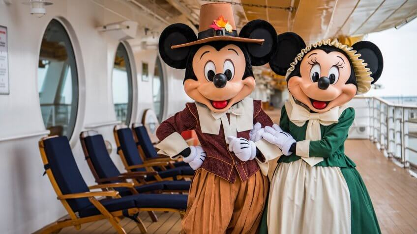 """In the spirit of holiday cheer, Disney Cruise Line adds sparkle to each ship during Very Merrytime Cruises, with Disney characters dressed in festive attire, special stem-to-stern holiday events, traditional """"turkey day"""" fanfare, Christmas feasts, """"snow flurries"""" and New Year's Eve galas."""