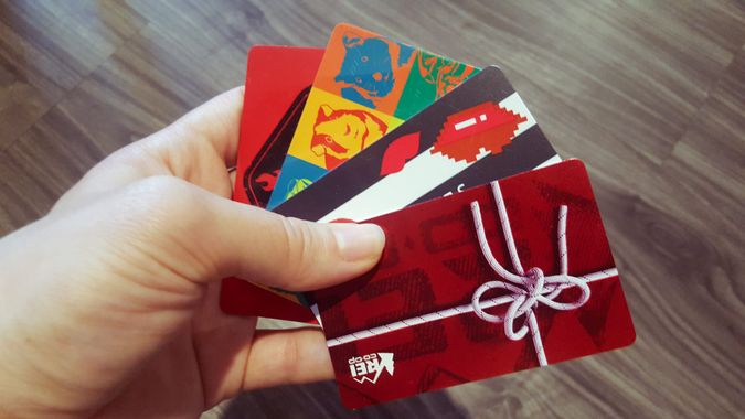 Colorful gift cards in person's hands