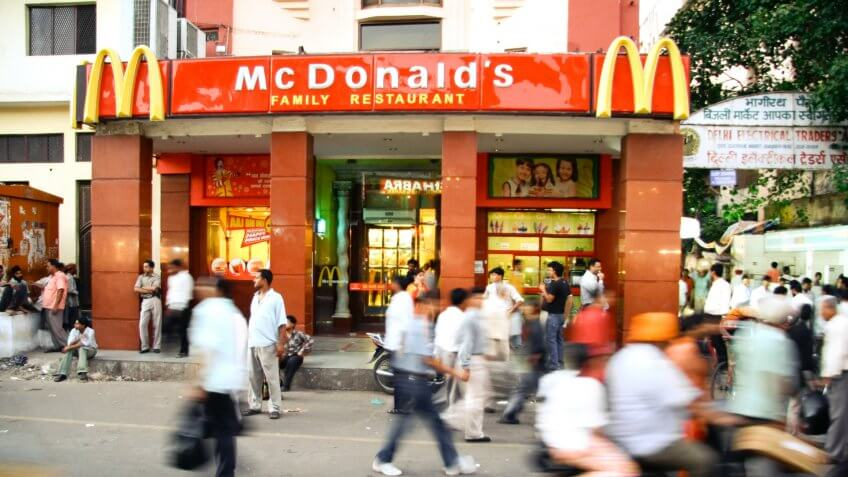 DELHI - SEPTEMBER 15: Crowds passing in front of McDonald's on September 15, 2007 in Delhi, India. It's the only country in the world that does not offer beef on its menu.