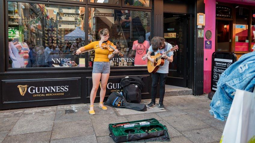 Dublin, JUL 1: Street artist performing music with violin and guitar on JUL 1, 2018 at Dublin, Ireland.