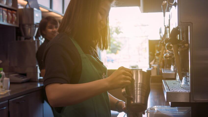 Starbucks barista making a coffee drink