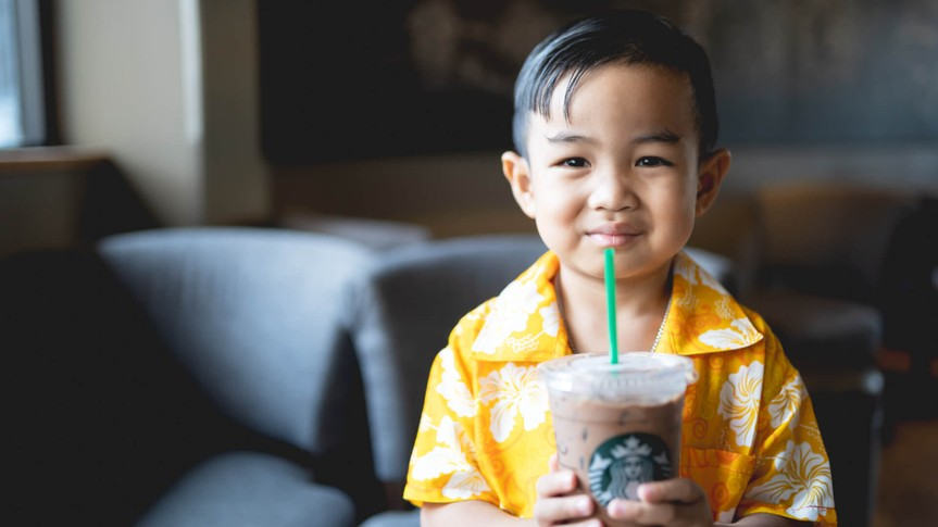 starbuck coffee at Bangkok,Thailand : 13 april 2017 : Asian baby boy holding and surf coffee.