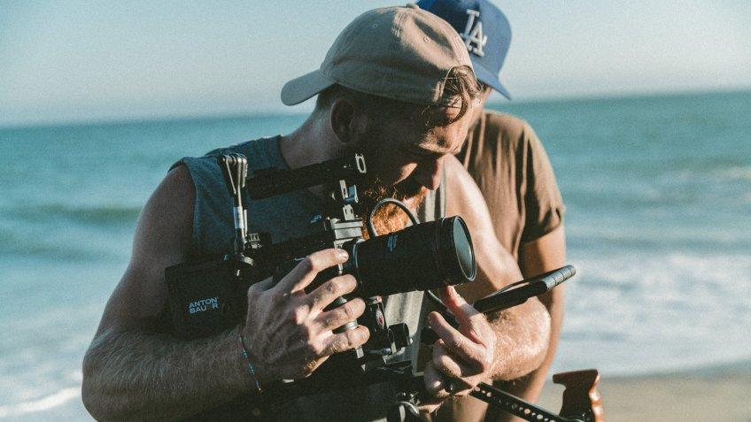 cameraman working freelance job on the beach