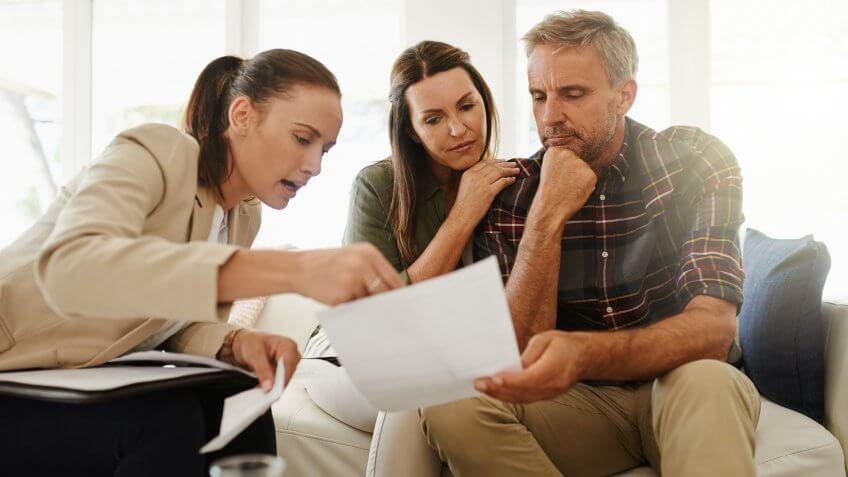 Shot of a mature couple getting advice from their financial consultant at home.