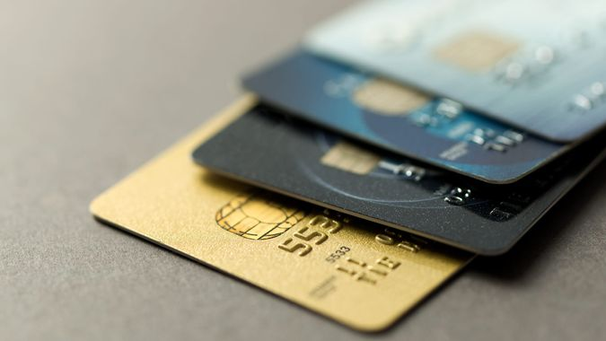 Close up of credit cards over grey background.