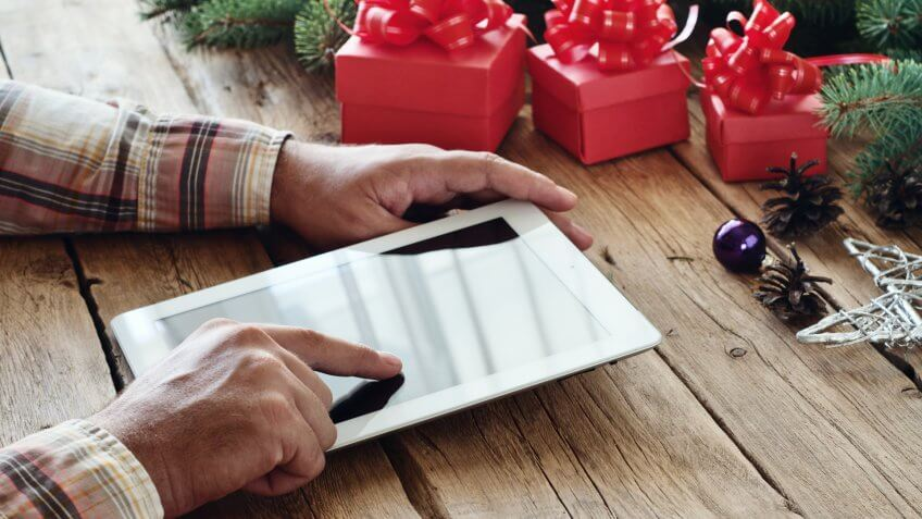 finding holiday coupon codes on tablet
