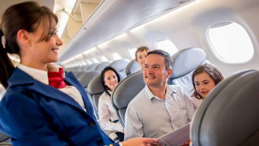 Family traveling by plane and enjoying the service onboard.