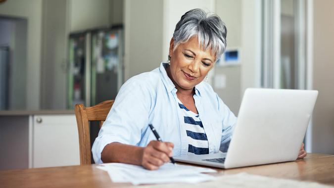 Cropped shot of a senior woman using a laptop to do the household finances.