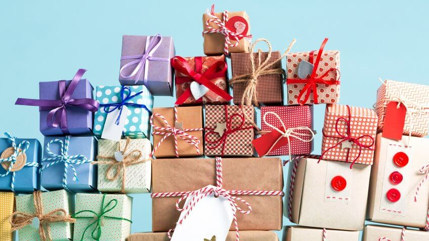 Collection of Christmas present boxes on a light blue background.