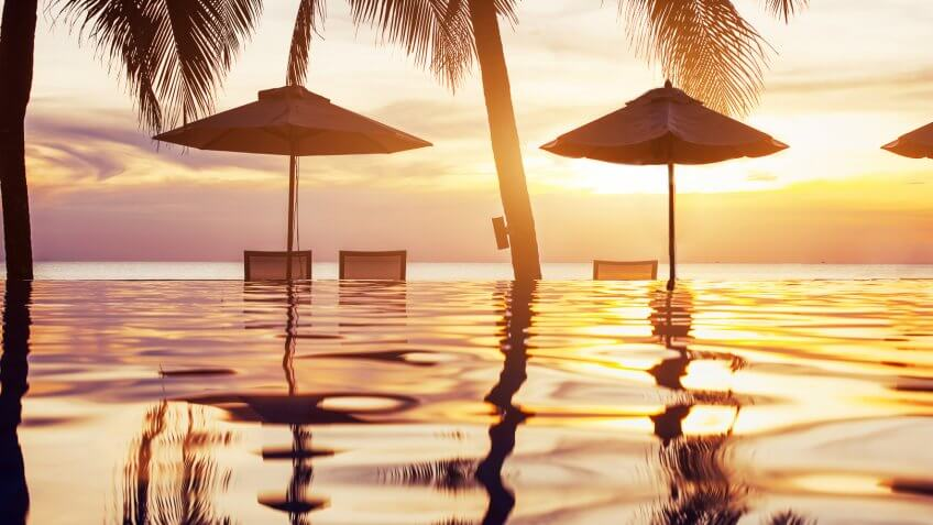 sunset at the beach and infinity pool resort