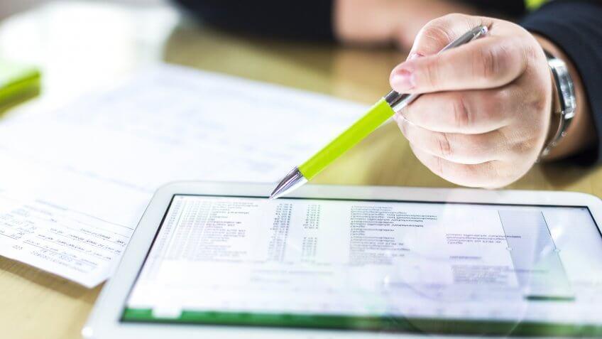 tax preparer reviewing financial accounts