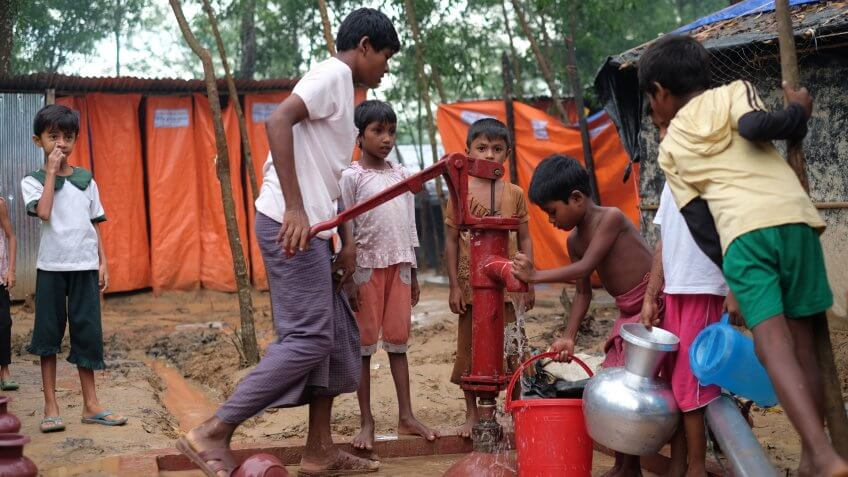 COX'S BAZAR, BANGLADESH : OCTOBER 8, 2017 - The Rohingyas took water in relief from non-governmental organizations (NGO) at the refugee camp in Kutupalong.