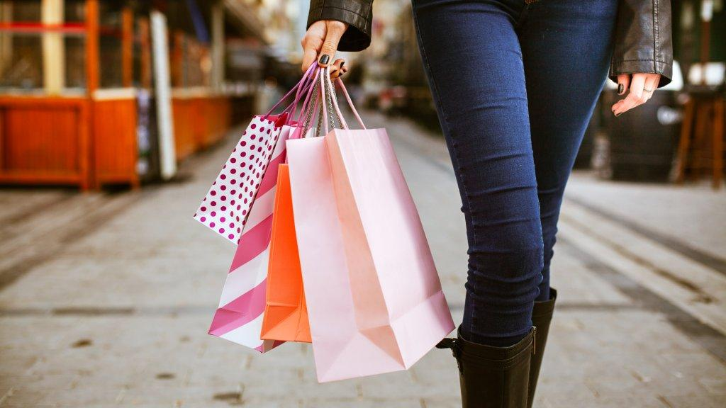 woman walking with shopping bags during holidays