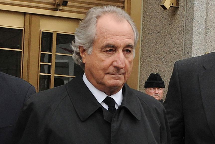 Mandatory Credit: Photo by Louis Lanzano/AP/Shutterstock (11857865a)Bernard Madoff exits Manhattan federal court, in New York.