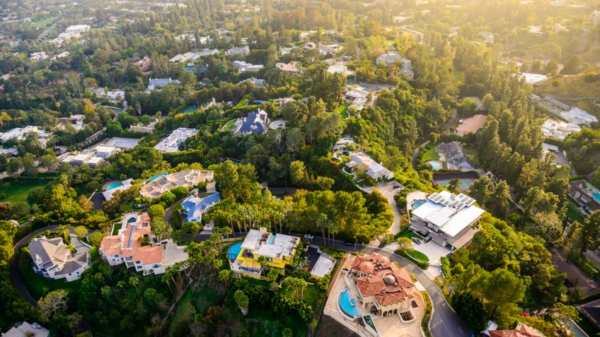 Los Angeles California - Beverly Hills landscape and mansions aerial view late afternoon.