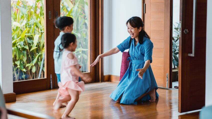 Children running to their mother when she comes home.