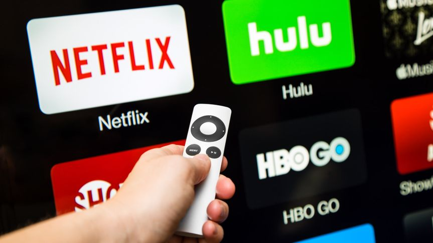 Canton, GA, USA - October 4, 2015 Netflix, hulu, and hbo subscription streaming video service accessed through a Apple tv and displayed on a hd tv.