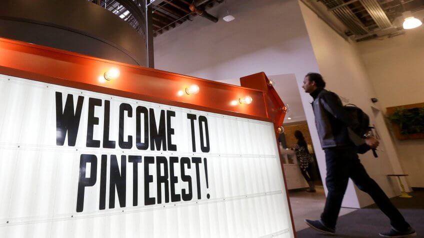 Photo by Jeff Chiu/AP/REX/Shutterstock A man walks past a sign at the Pinterest office in San Francisco, .