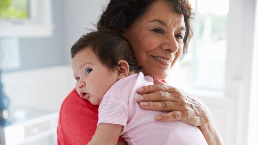 Proud Grandmother Holding Baby Granddaughter.