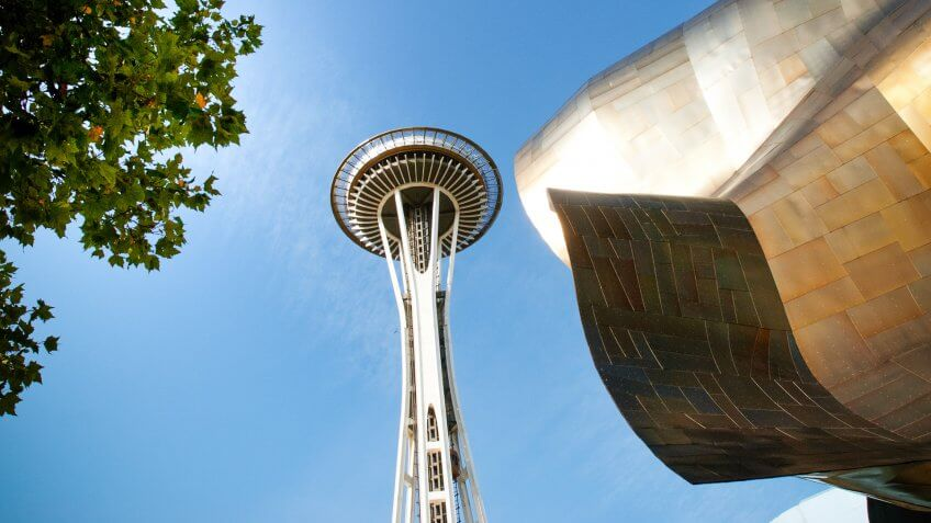 """Seattle, United States - September 19, 2011: Space Needle is a tower and a symbol of Seattle, the tower is located in Seattle Center, which is a cultural center and in this square there is also the interactive museum of music with its irregular structure and futuristic""."