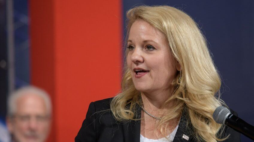 SpaceX President and Chief Operation Officer Gwynne Shotwell gives remarks during a NASA event announcing the astronauts assigned to crew the first flight tests and missions of the Boeing CST-100 Starliner and SpaceX Crew Dragon, Friday, Aug.