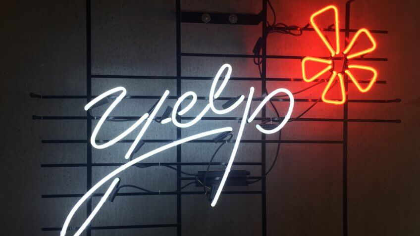 San Francisco,CA August 22 2018: Neon Lighting Yelp Internet Review company logo at Yelp Headquarters Cafateria.