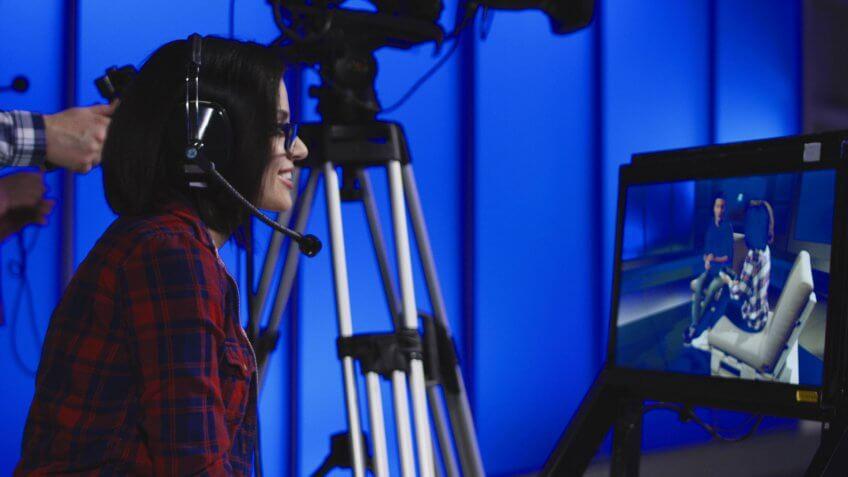 female art director watching set on monitor