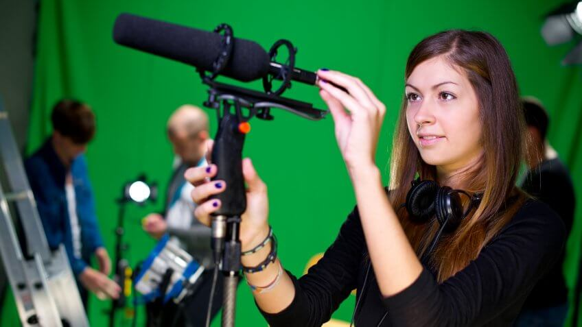 media student in college tv studio.