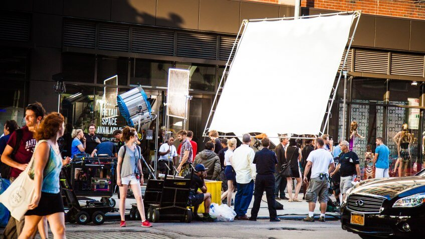New York City, New York, United States - August 21, 2014: Cameramen and crew setting up a shoot on street in Chelsea, New York for a movie set.