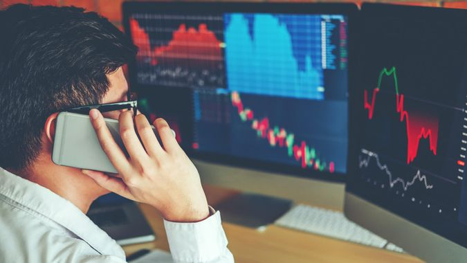 Business Man Using Mobile phone Investment discussing and analysis graph stock market trading,stock chart concept.