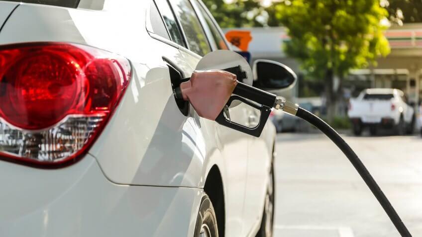 pumping gasoline into car