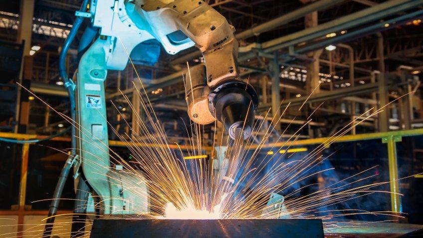 Industrial robot is test run welding in car factory.