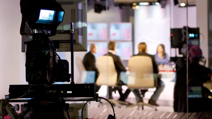 Recording live talk show at television studio.