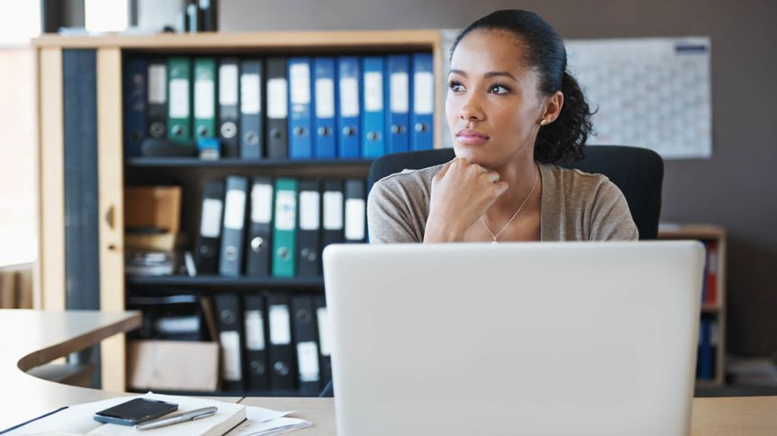 Shot of a businesswoman sitting behind her laptop in the office.