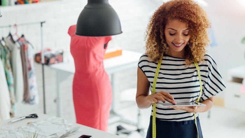Latina tailor or fashion designer in her workshop.