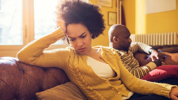 Angry African American woman had a fight with her boyfriend at home.