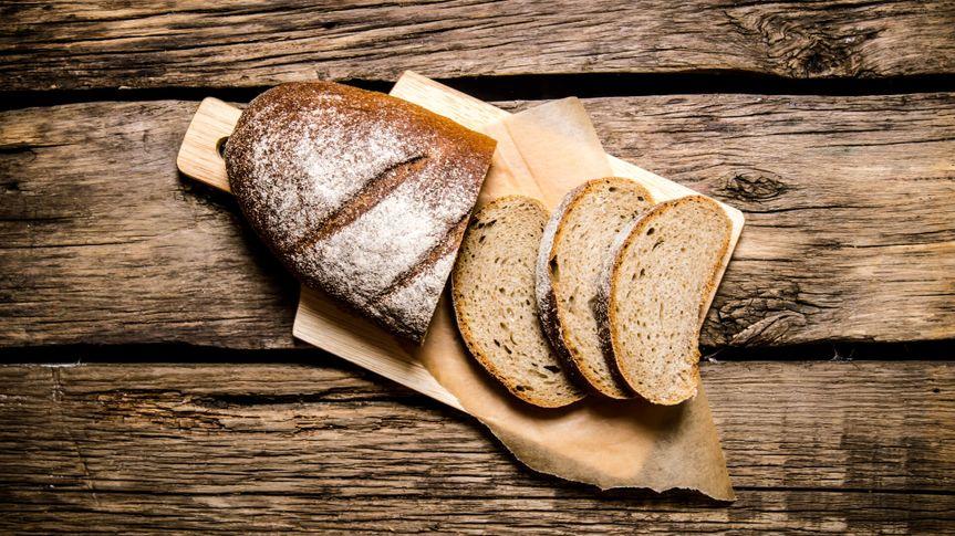 artisanal bread on wood cutting board