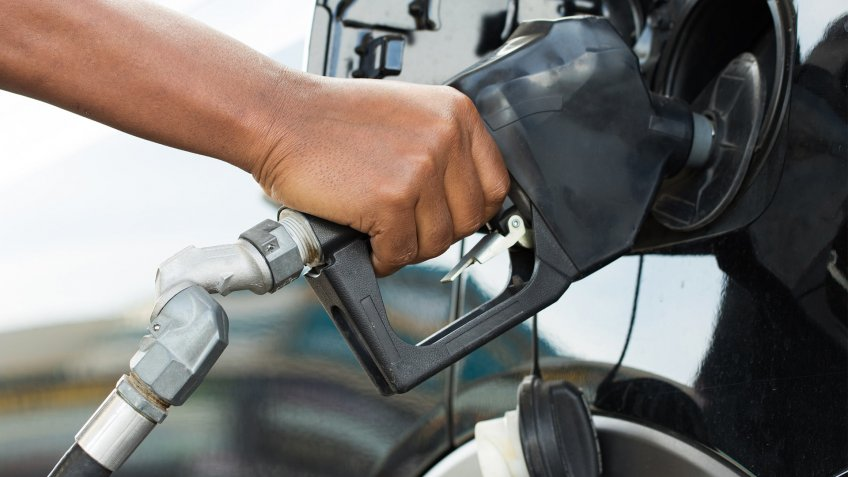pumping gas into fuel tank