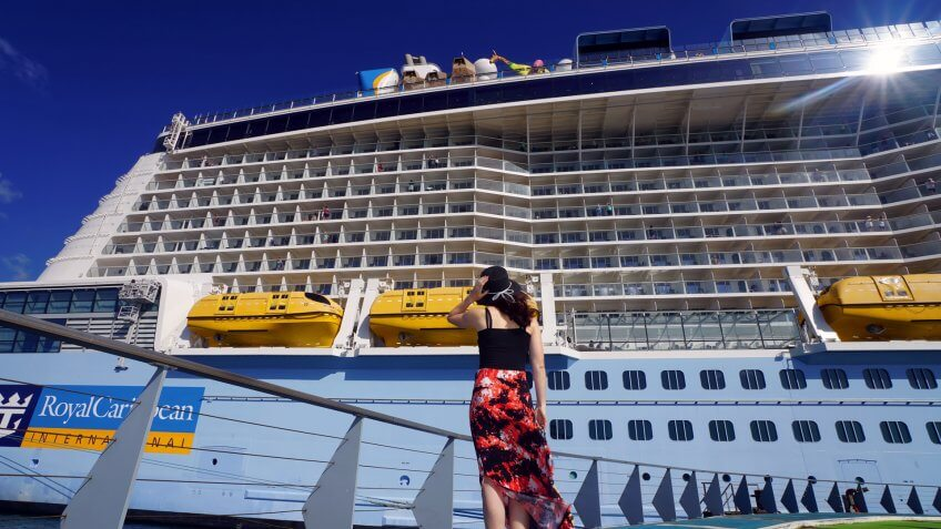 Fort-de-France, Martinique - April 23, 2017: On Pier, a woman is looking at Anthem of the Seas cruise ship.