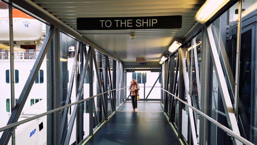 Southampton, UK: August 24, 2018: Passengers board on ocean liner docked at port.