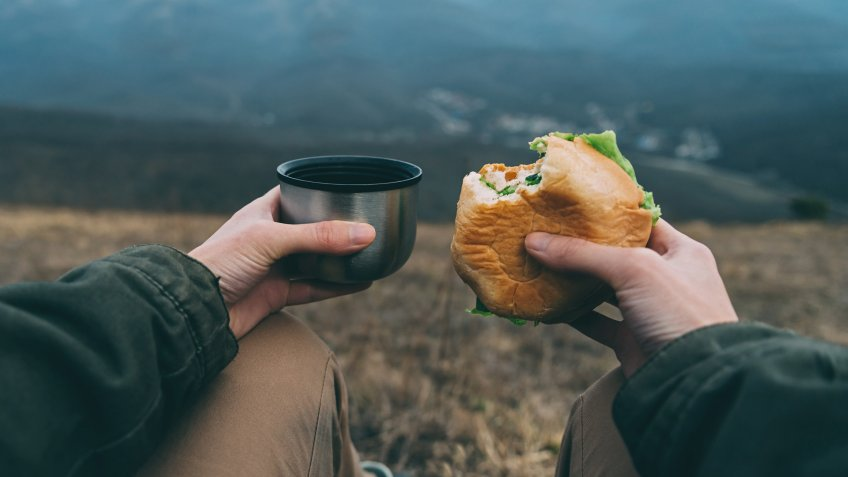 eating a sandwich while hiking