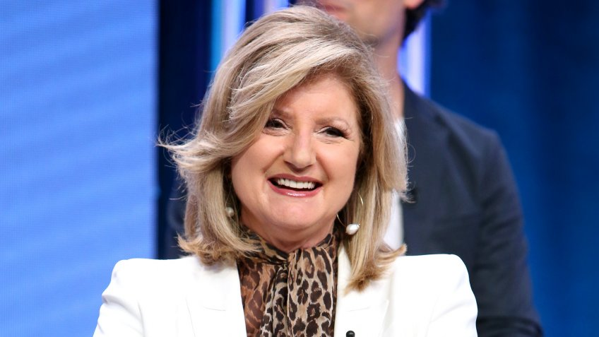 Arianna Huffington smiling on National Geographic Valley of the Boom tv show panel