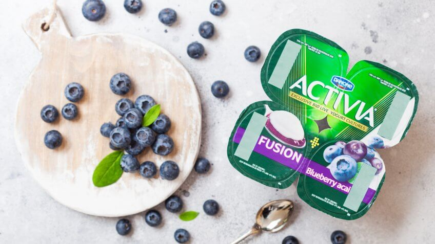 LONDON, UK - SEPTEMBER 26, 2018: Activia yogurt with blueberries by Danone with berries.