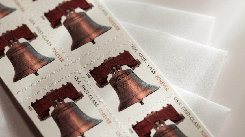 Booklet of USA Forever Stamps on envelopes.