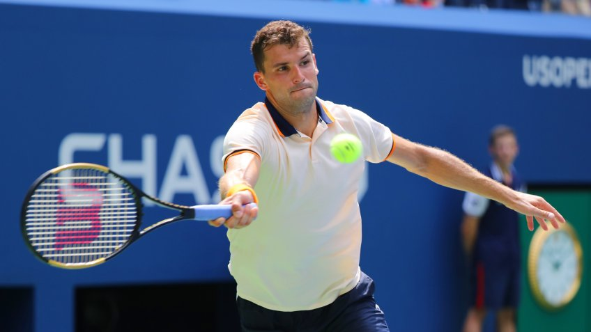 NEW YORK - AUGUST 27, 2018: Professional tennis player Grigor Dimitrov of Bulgaria in action during first round match at 2018 US Open at USTA National Tennis Center - Image.