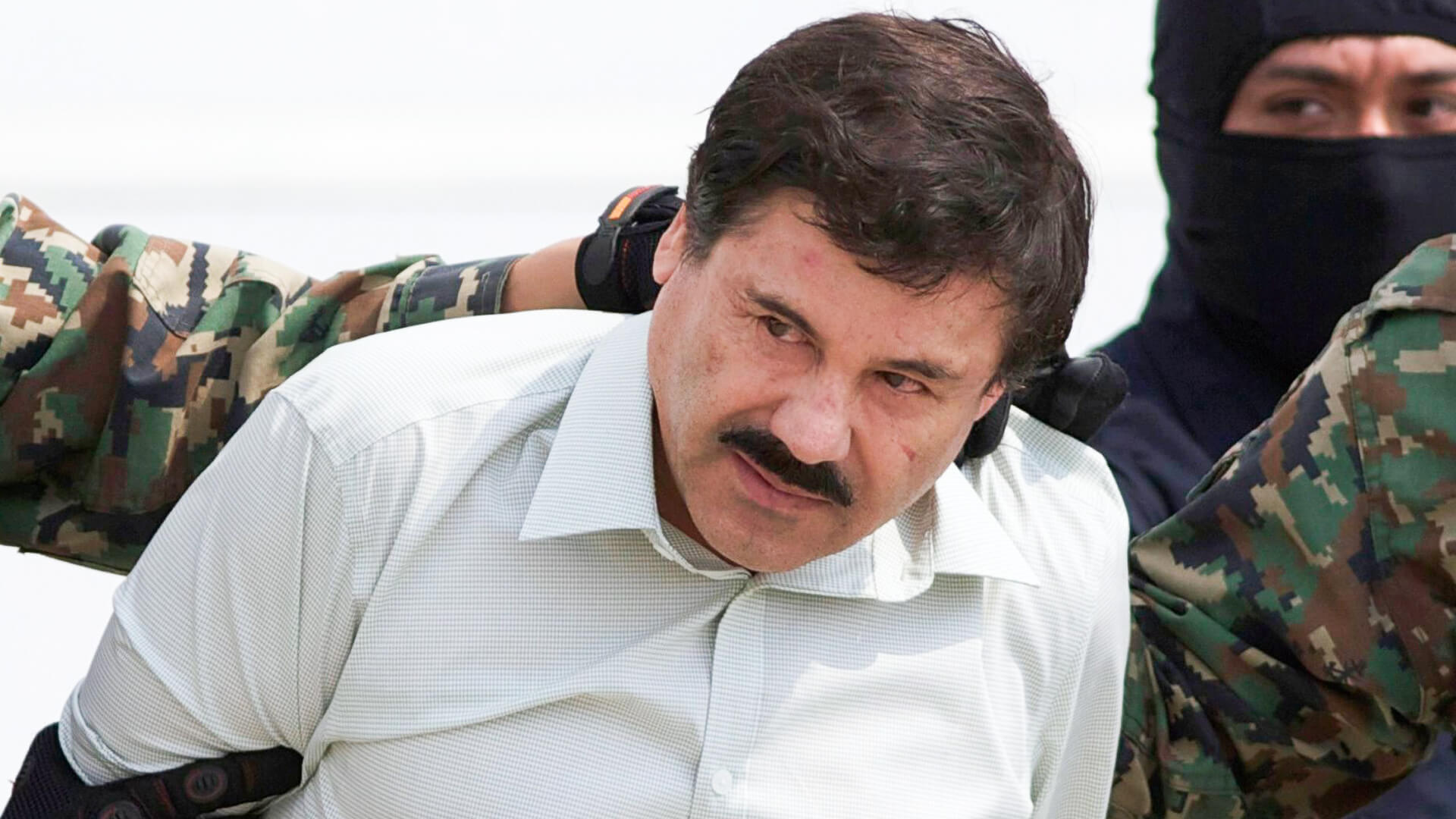"Mandatory Credit: Photo by Eduardo Verdugo/AP/REX/Shutterstock (6753558a) Joaquin ""El Chapo"" Guzman Joaquin ""El Chapo"" Guzman, head of Mexico's Sinaloa Cartel, is escorted to a helicopter in Mexico City, following his capture overnight in the beach resort town of Mazatlan."